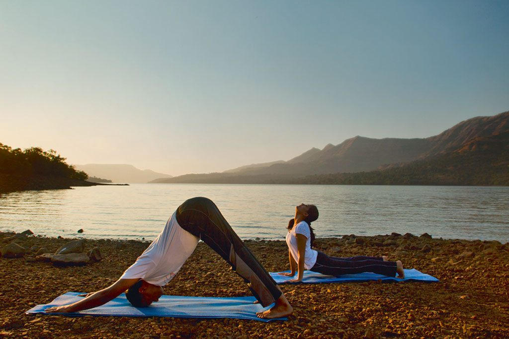 Mornings at Kare wellness centre begin with Iyengar yoga sessions by the lake. Photo courtesy Kare Ayurveda & Yoga Retreat