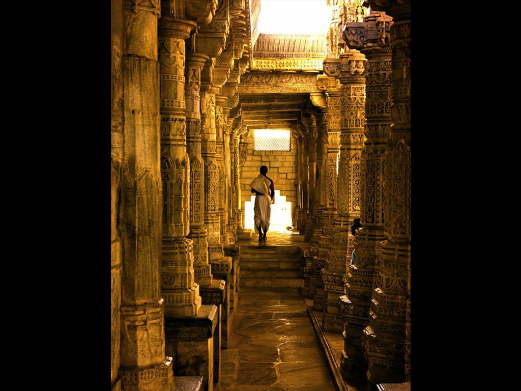 """""""I happened to stop by this Jain temple in Ranakpur on my way to a small village in Rajasthan. In the sweltering heat, the cool marble and peace and quiet of the temple was more than welcoming. While exploring this ancient monument, I saw this priest finishing his prayer routine and had to capture the scene."""" Photo: Neha Parmar"""