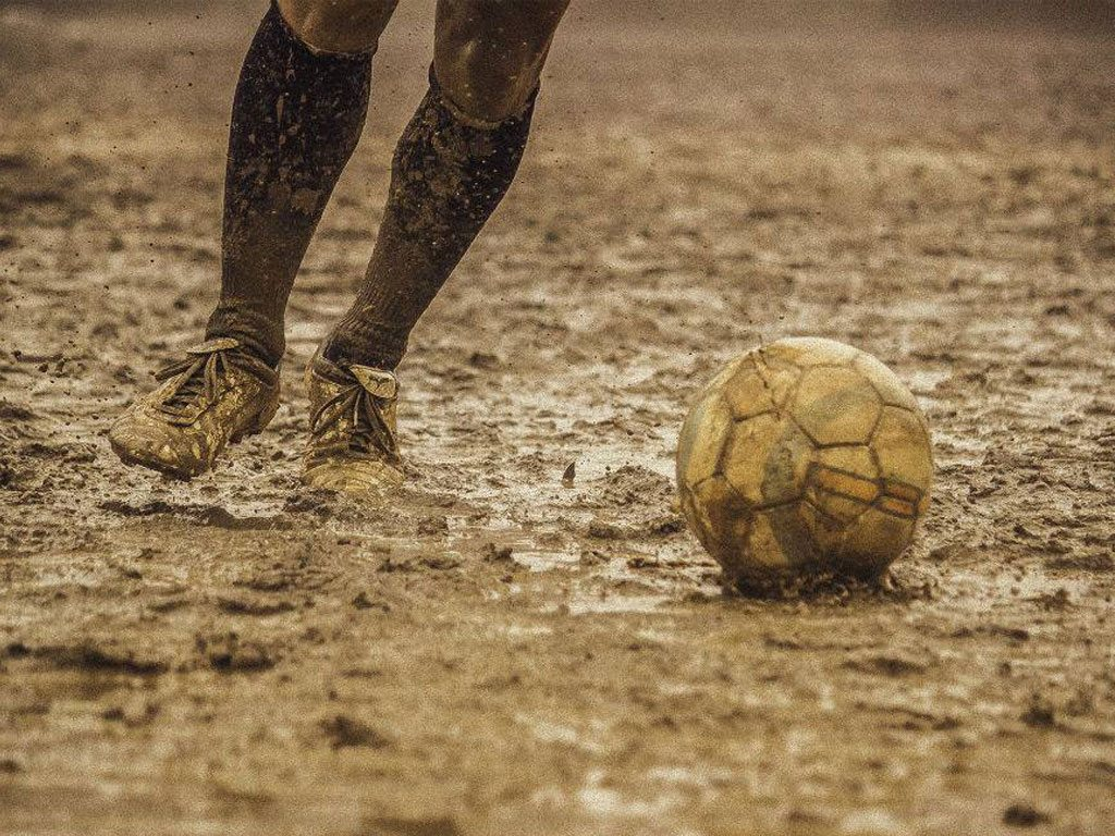 football in the rain, photo by Manprit Singh Shergill