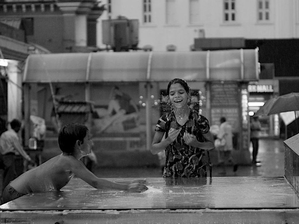 children splashing around, photo by Avishek Datta