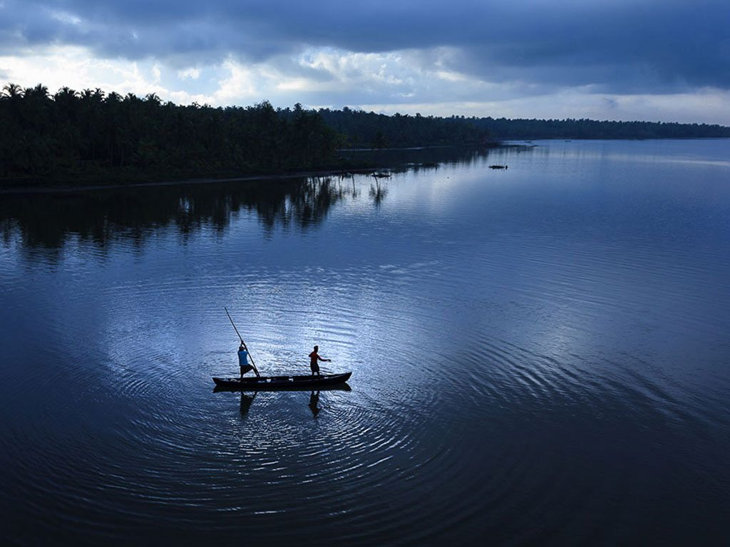 men in a boat, photo by Sreeranj Sreedhar