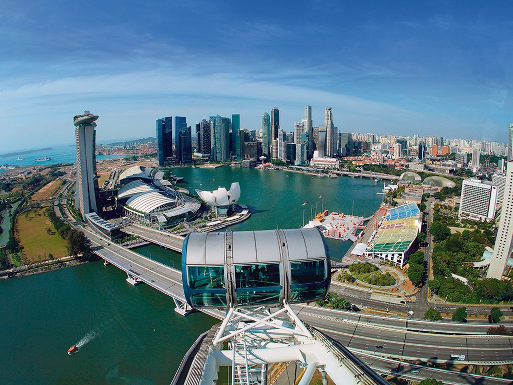 Each viewing pod of the Singapore Flyer is about the size of a city bus, and affords an excellent vista of Singapore's skyline. Photo: Suttipon Thanarakpong/Shutterstock