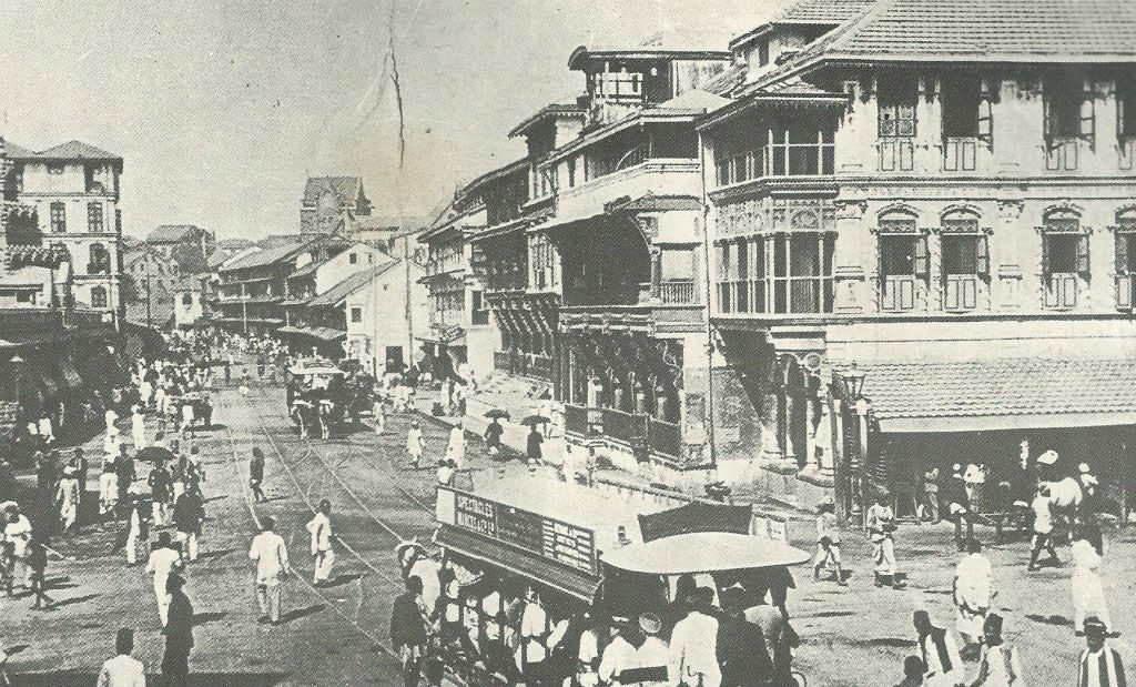 Horse-drawn trams were the first avatars of buses in Mumbai. On the right, you can see a stable for the horses.