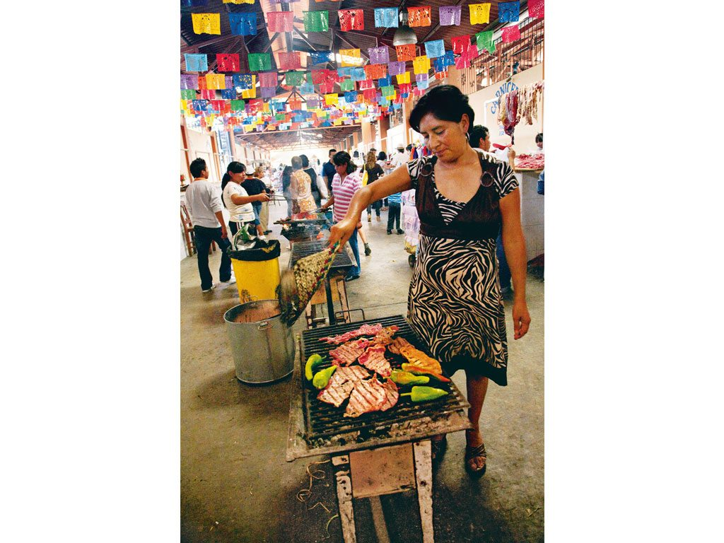 Mexican markets are full of comedores, or food stalls selling grilled meat and other Oaxaqueño delights. Photo: 81 John & Lisa Merrill/Getty Images