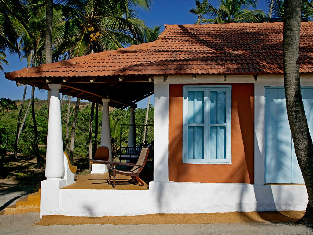 Unwind with a cool beer on the porch of one of Goa's trademark Portuguese homes. Photo courtesy Elsewhere