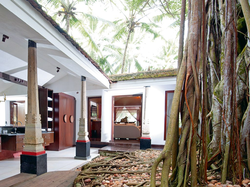 The Banyan Tree Bungalow is the perfect setting for a romantic escape, with a private sit-out and an outdoor shower. Photo courtesy Niraamaya Retreats Surya Samudra