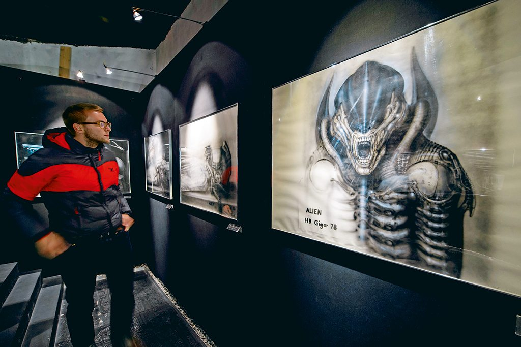 """Gruyères' more outlandish tourist draws include artworks of extraterrestrial creatures designed by Swiss artist H.R. Giger, including those for the film """"Alien"""". They are on display at Museum HR Giger. Photo: Abrice Coffrini/Staff/AFP/Getty Images"""