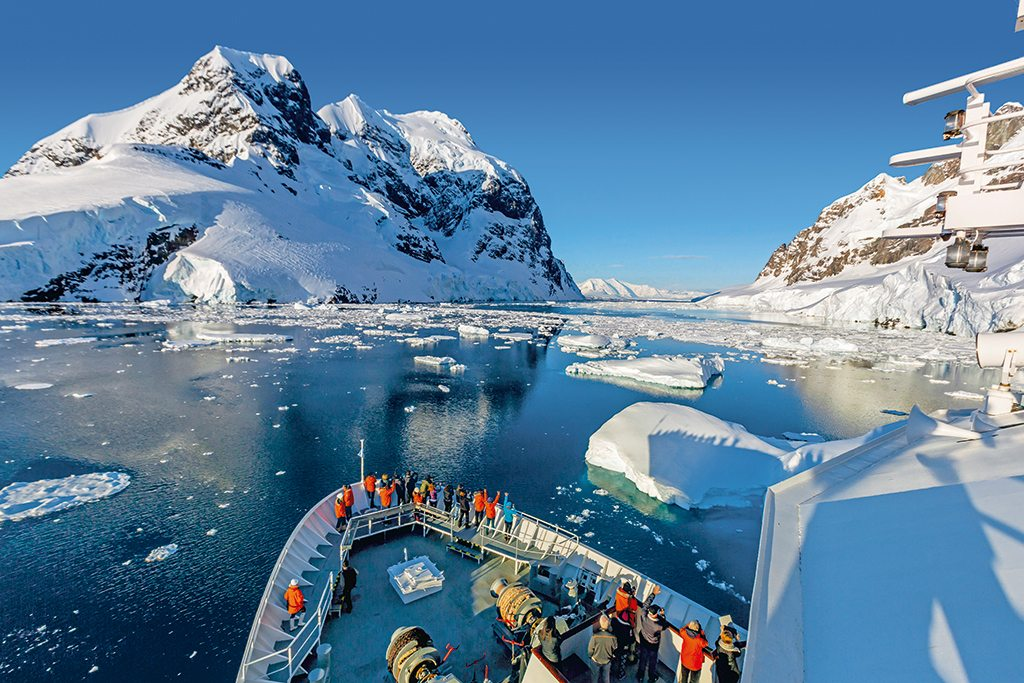 Antarctica's 11-kilometre-long, 5,200-foot-wide Lemaire Channel, flanked by looming icebergs, is one of the most picturesque in the world. The National Geographic Explorer traverses the channel on its way to Petermann Island. Photo: Michael Nolan/©RobertHarding/Alamy/Indiapicture