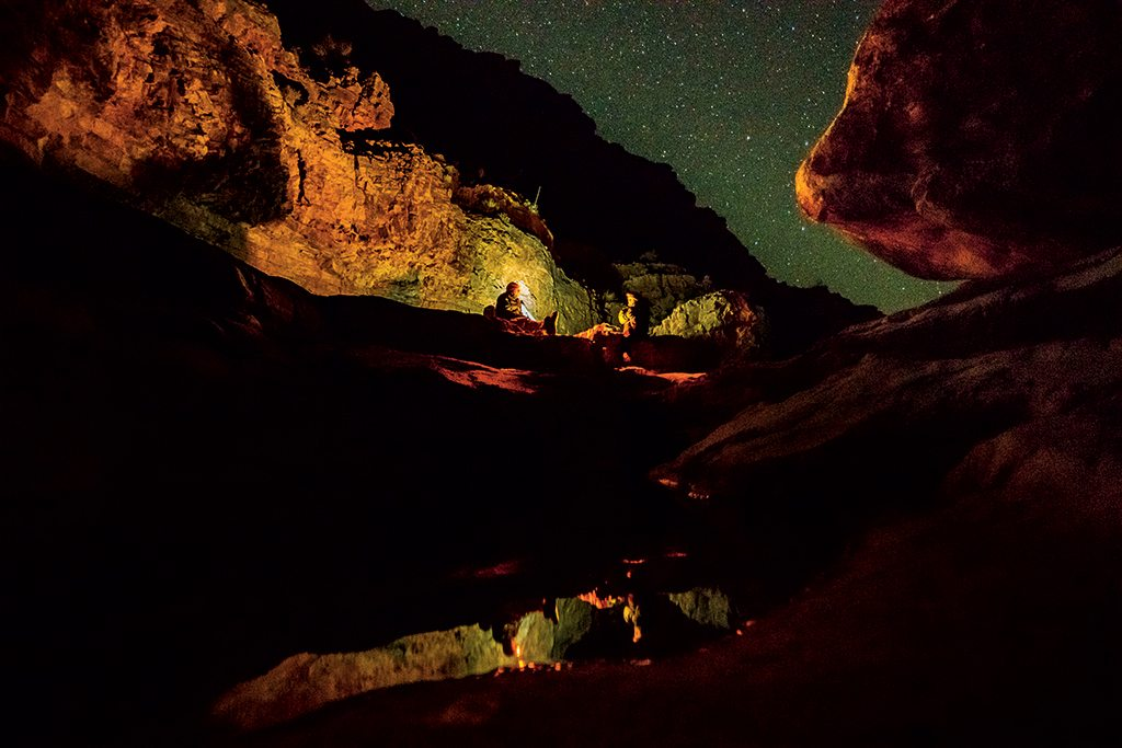 Backcountry explorer Rich Rudow (at left) and the author eat dinner beside a spring in Olo Canyon, one of the Grand Canyon's numerous tributaries. Similar oases could be damaged by proposed developments near the park, which, if built, could diminish or contaminate the aquifer that supports life on the South Rim. Photo: Pete McBride