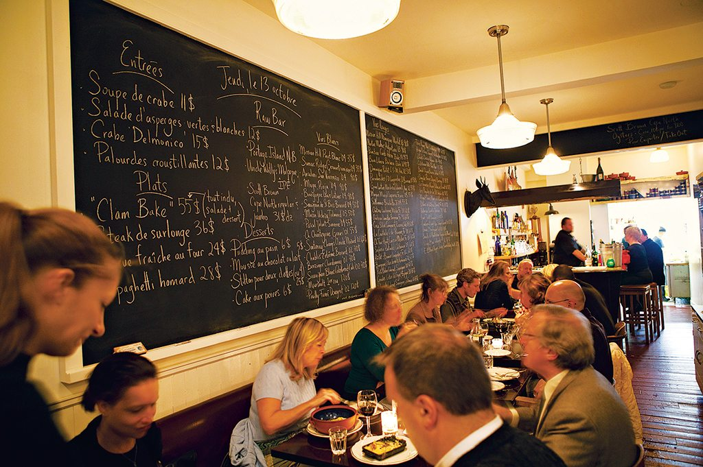 A chalkboard lists the menu at Joe Beef. Photo: Susan Seubert