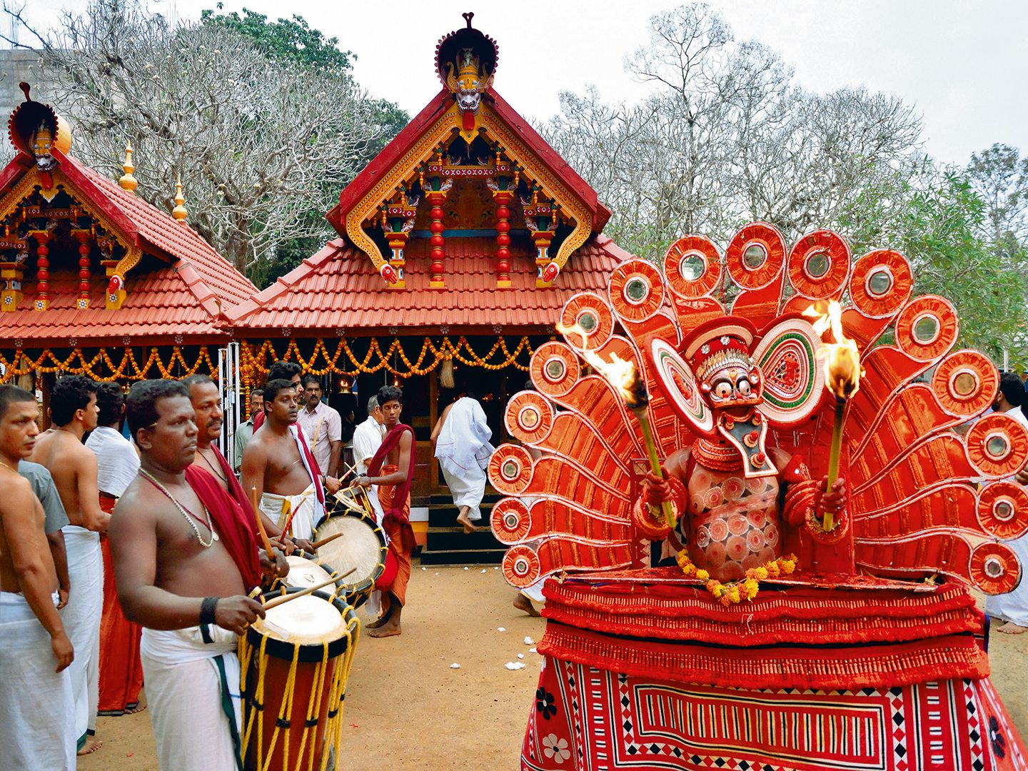theyyam dancers, kannur, photo by Christ Ophe Boisvi Eux/Age Fotostock/Dinodia Photo Library