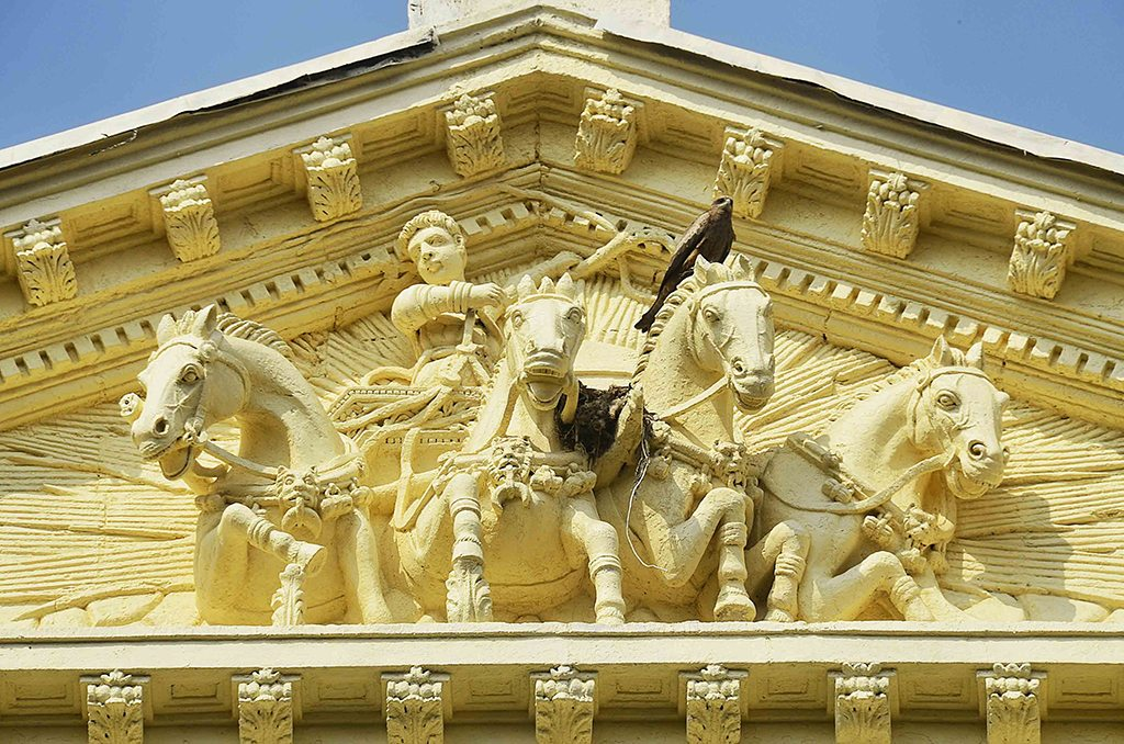 The Greek god Apollo marks the Sun Life Assurance Company of Canada building on Dadabhai Naoroji Road. The road has a number of buildings with fine carvings and sculptures on their facades. Photo: Sharrell Cook