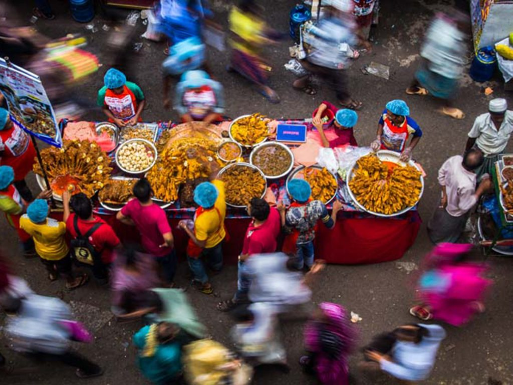 During Ramzan, Muslims fast from sunrise to sunset to celebrate the revelation of the Quran to the Prophet Muhammad. These street vendors in Dhaka hawk their snacks to passersby as the day draws to an end.