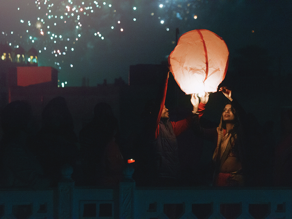 Makar Sankranti is celebrated in many ways across India. Some folks fly kites while others, like this couple in Jaipur, release sky lanterns to mark the occasion.