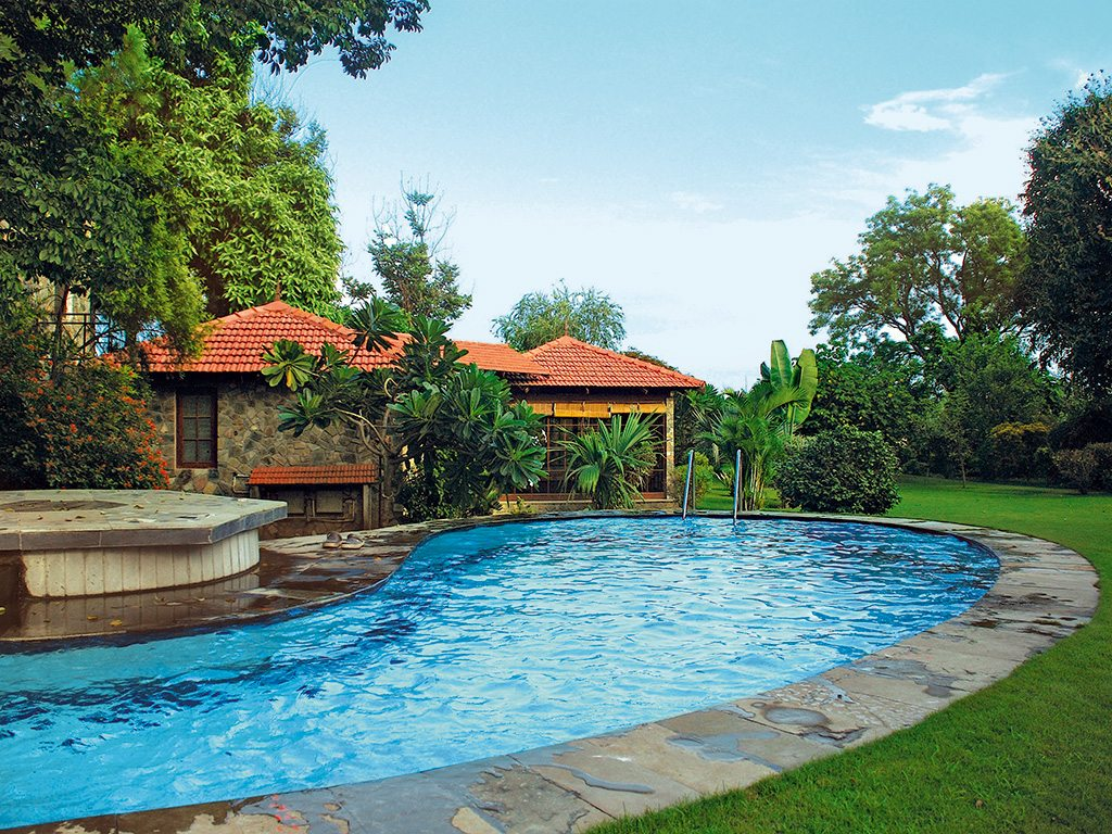 The Homestead offers cosy rooms, sprawling gardens, and a luxurious swimming pool. Photo: Shikha Tripathi