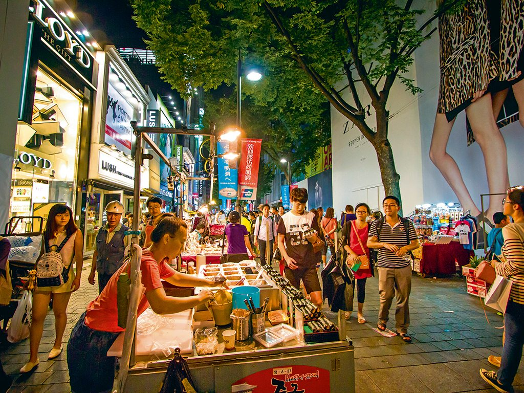 Street vendors do brisk business in Myeongdong. Photo: Sinseeho/Shutterstock