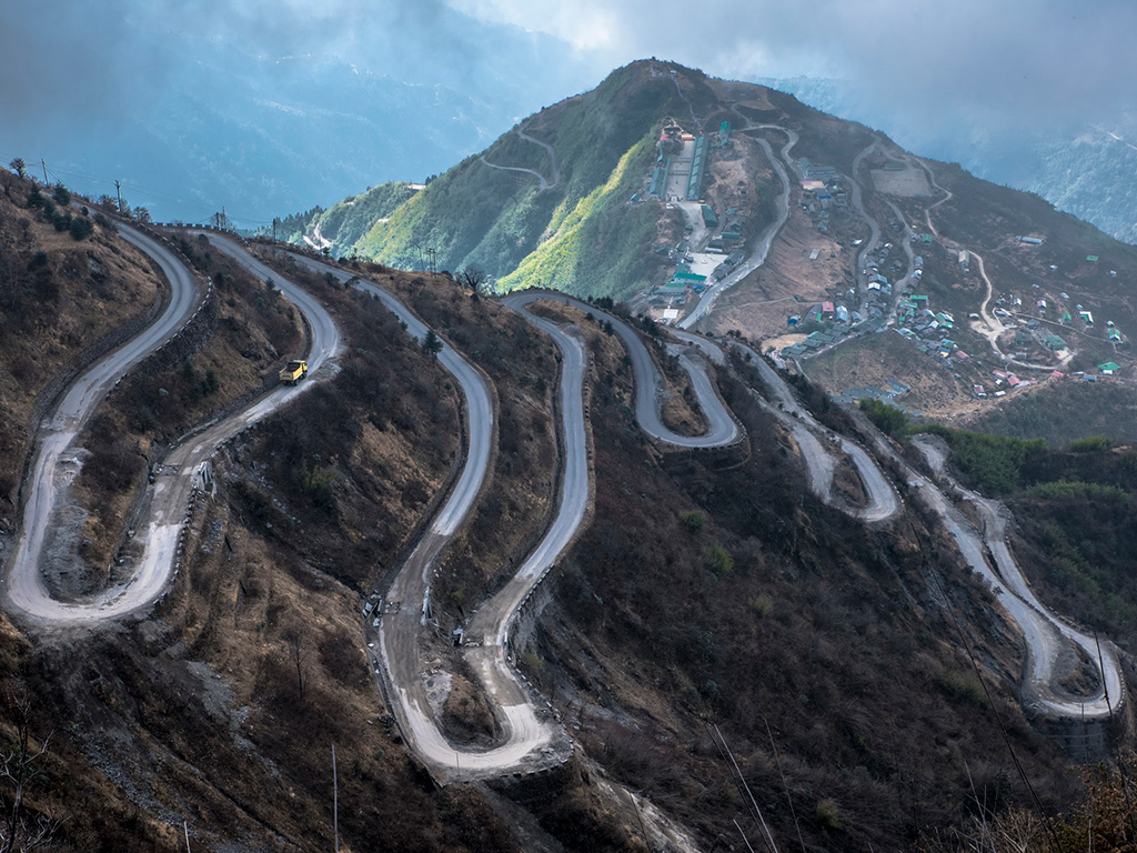 "Sikkim's Thambi view point, near the town of Zuluk, overlooks this zig-zagging road that is locally called ""bhul bhulaiya"" because of its many hairpins."