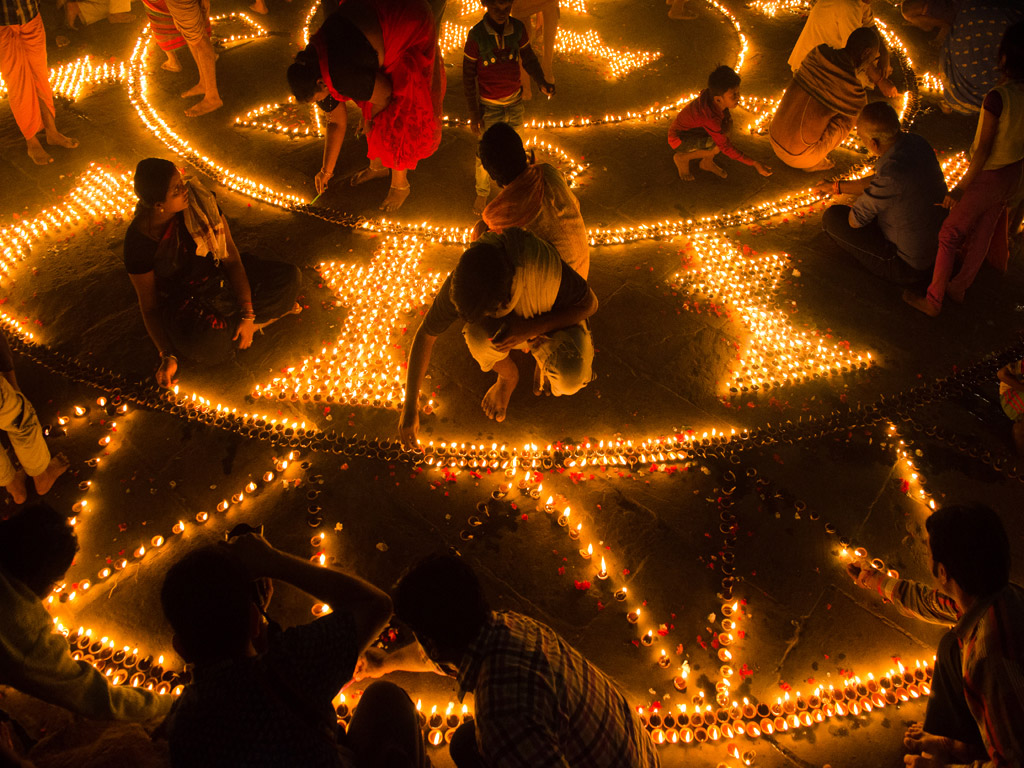 Varanasi's ghats are lit with thousands of diyas on the occasion of Dev Diwali.