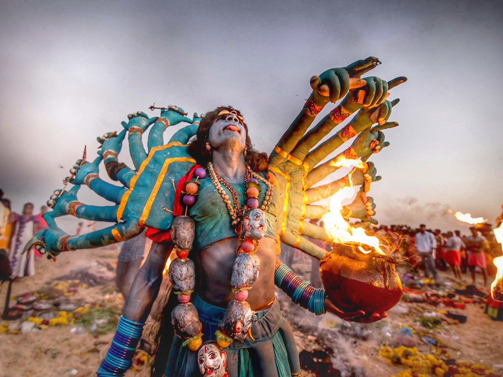 Devotees transform themselves into gods and goddesses during Dussehra celebrations in the coastal town of Kulasai, in Tamil Nadu.