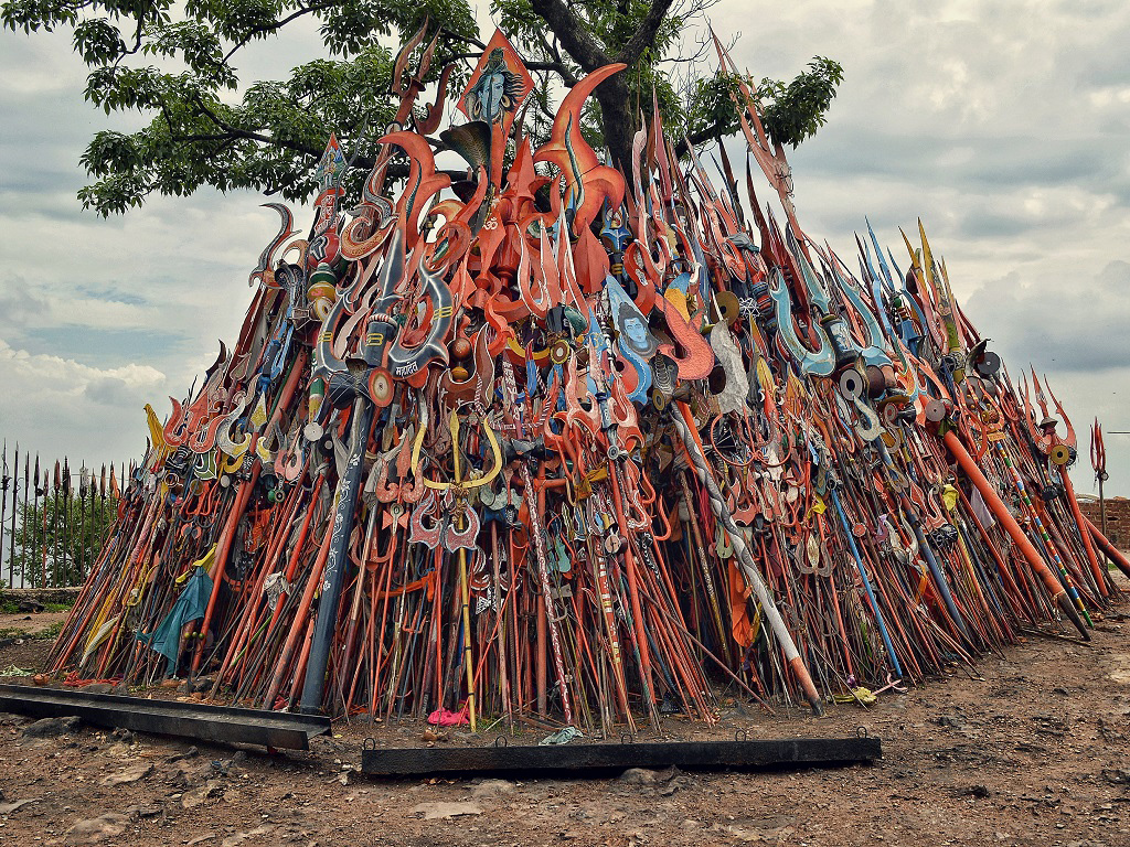 Trishuls, or tridents, are stacked against a tree near the Chauragarh Shiva temple in Pachmarhi, Madhya Pradesh.