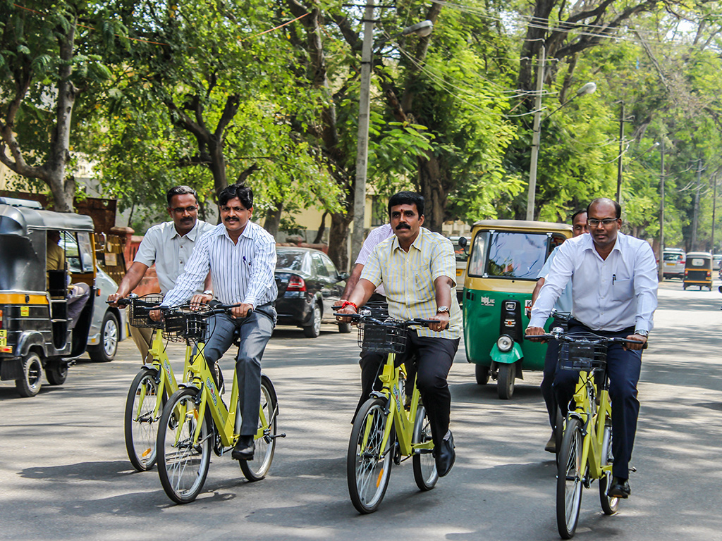 volunteers try mysore trintrin public bicycle share system
