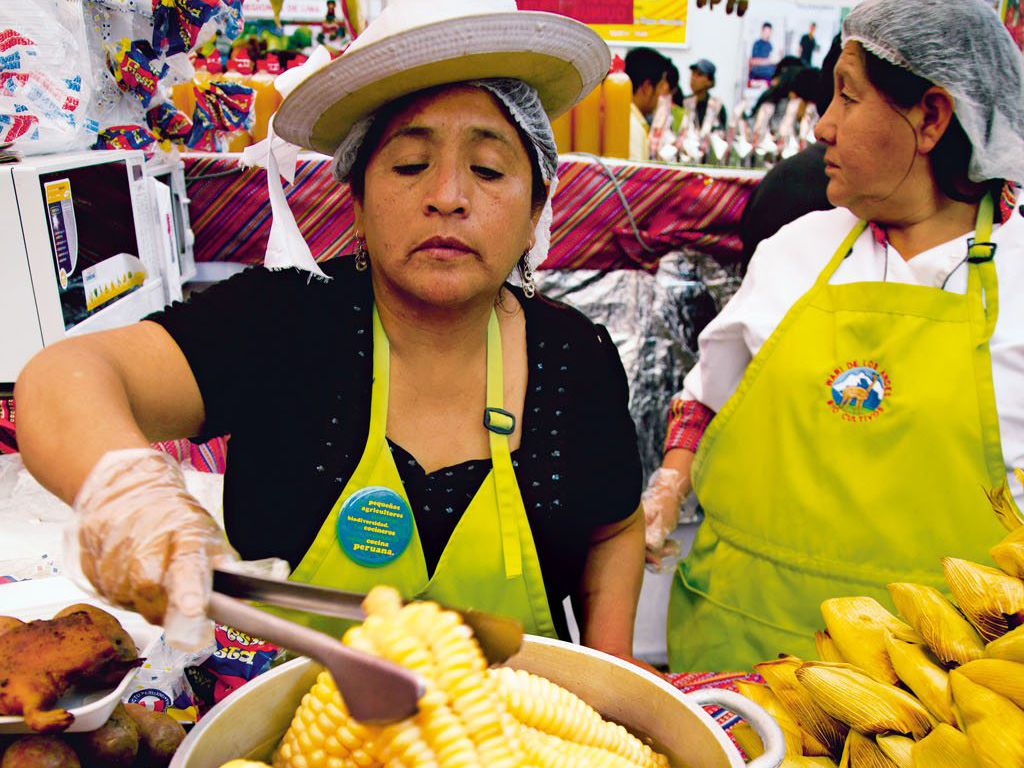 At the Mistura Festival, a local serves up choclo, or Peruvian large-kernel corn. Photo: Nicholas Gill/Alamy