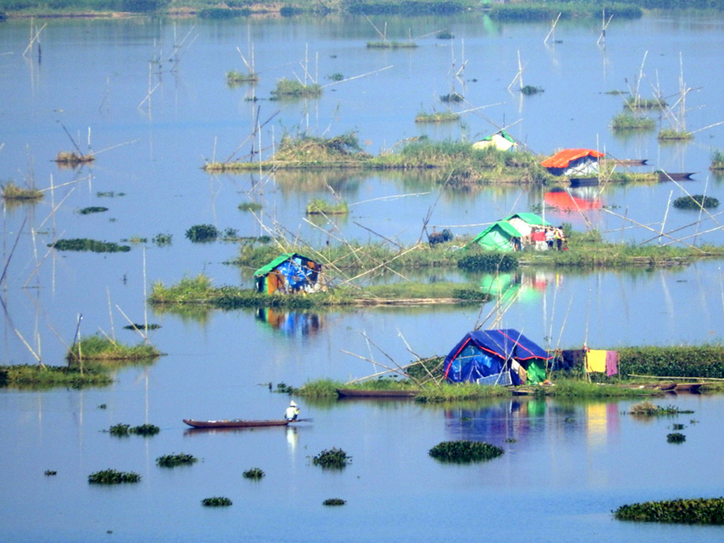 "Fishermen's huts dot the ""phumdis"" or floating islands on Manipur's Loktak Lake."