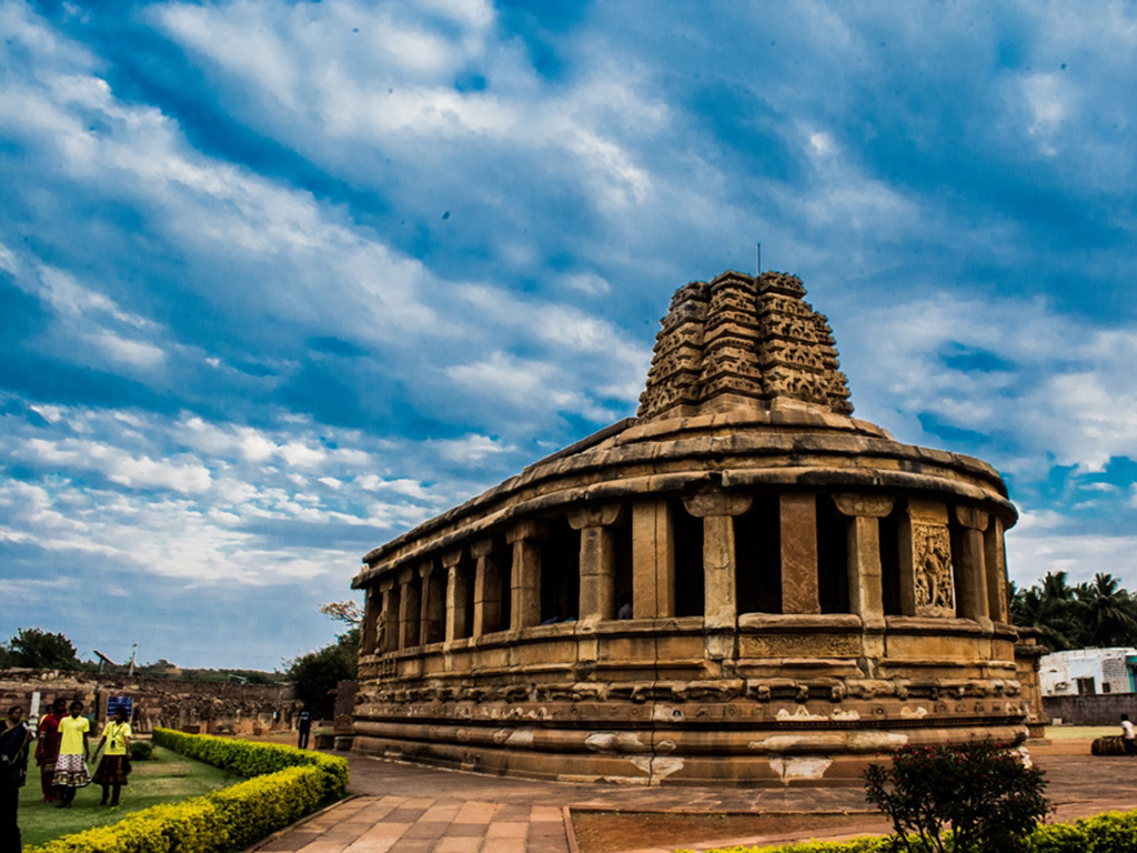 Badami's exquisite rock-cut cave temples—three Hindu and one Jain—make for a wonderful day trip from Hampi.