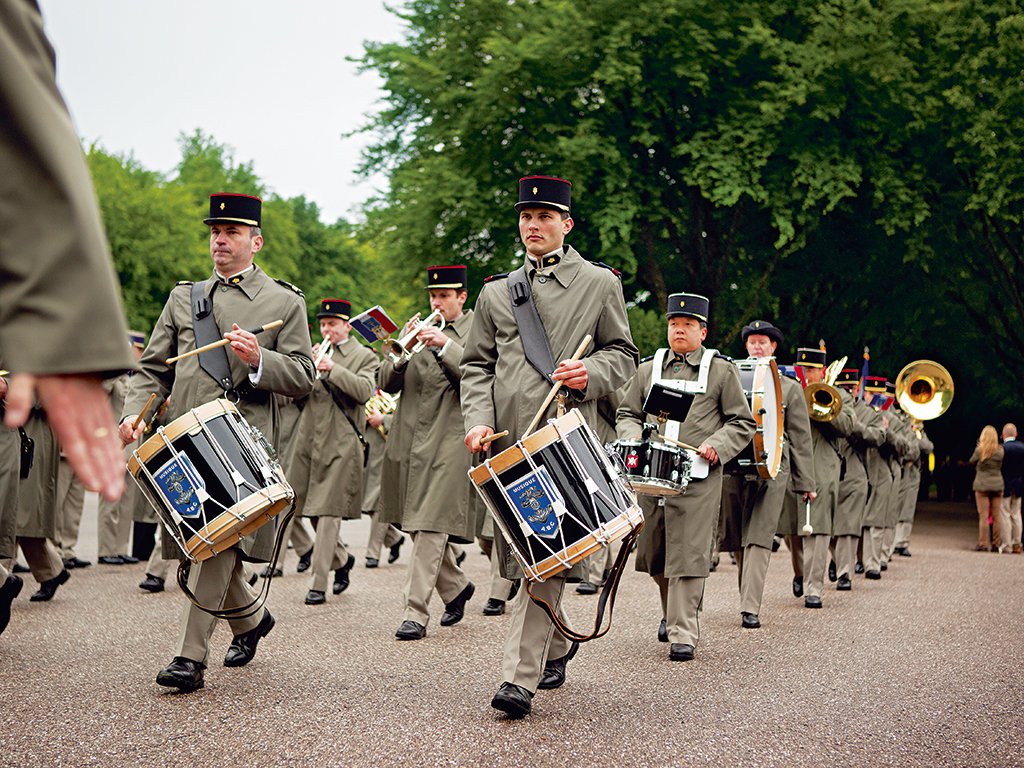 Remembering WWI sacrifice, a French military band marches at the Meuse-Argonne American Cemetery. Photo: Kris Davidson