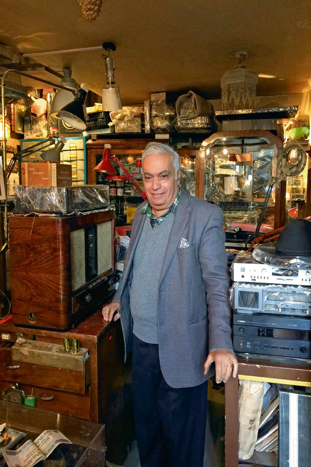 Mr. Raheb, music enthusiast and the owner of a vintage record and audio equipment shop in Zamalek, ensures that visitors have a great listening experience at his store, whether they make a purchase or not. Photo: Diya Kohli