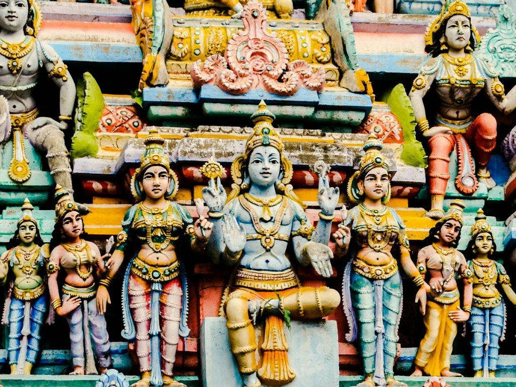 Like many temples in South India, this shrine from Pondicherry has a tall gopuram crowded with colourful figurines from Hindu mythology.