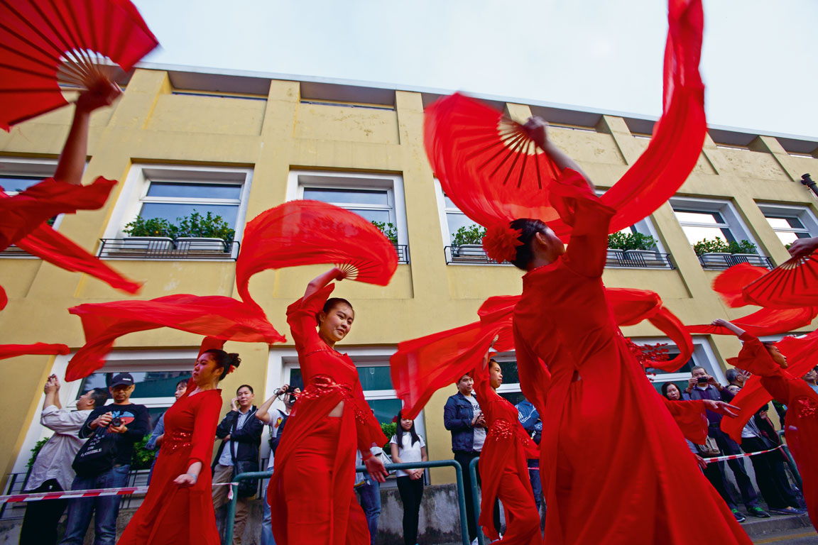 swirling dancers Latin City parade Macao