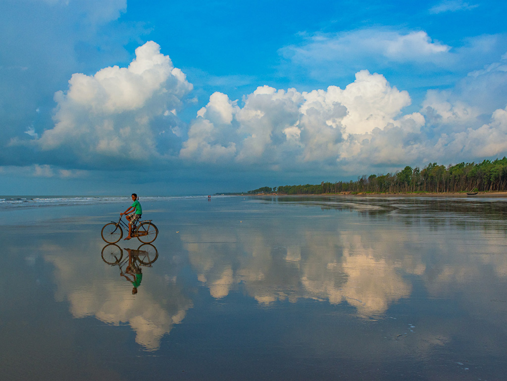 Blue skies, blue sea, and an almost perfectly symmetrical reflection. This was clicked at Tajpur Beach, West Bengal.