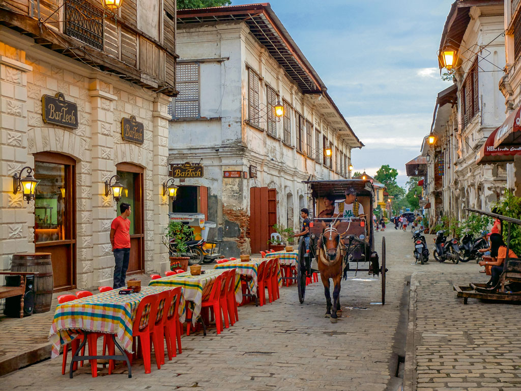 In Vigan city, one can experience Philippines' colonial past—from 16th-century buildings and horse carriages. Photo by Akarat Phasura/Shutterstock.