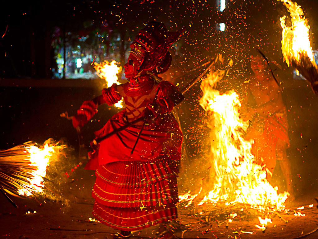 Today's Daily Shot captures the essence of Theyyam, Kerala's ancient dance form.