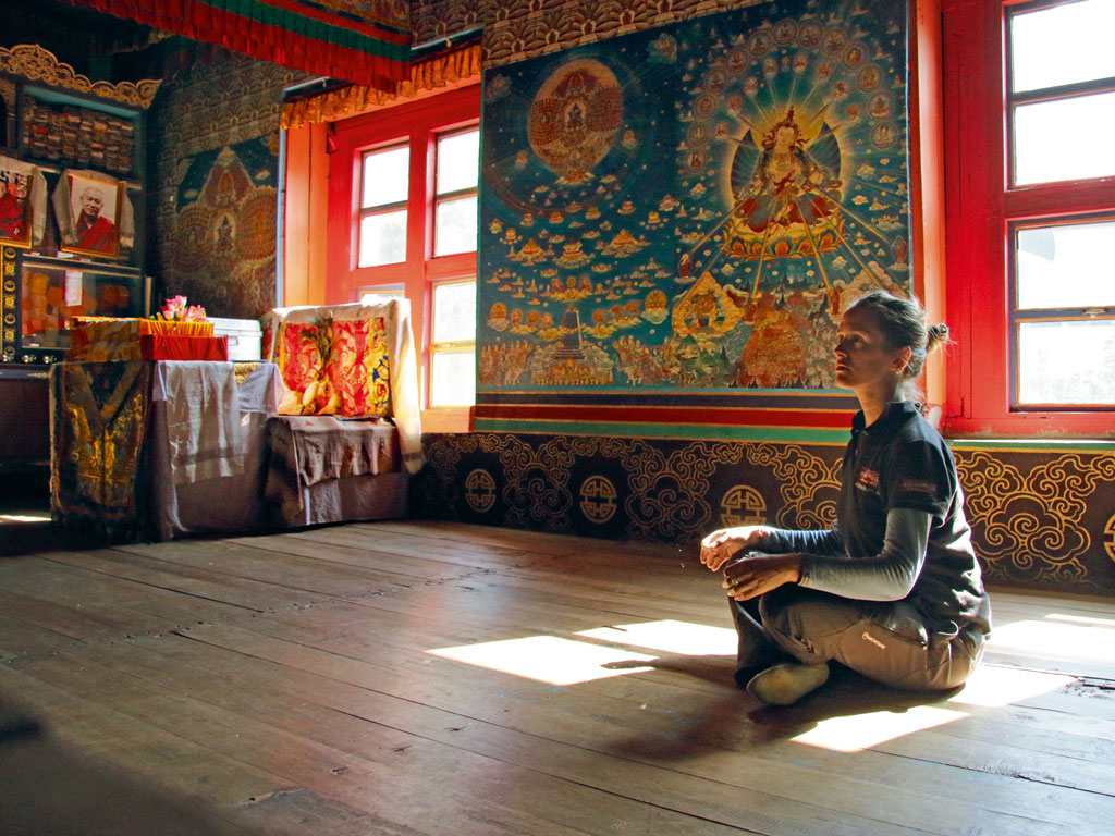 Antonia takes in the peace and beauty of Pemako's Devakotta Monastery.