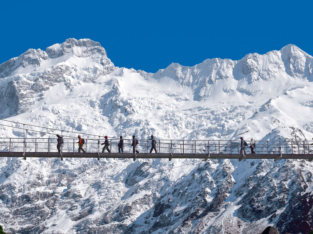 The Hermitage Hotel offers easy access to the best day-walk of Mount Cook National Park, The Hooker Valley Track. Its wobbly bridges and icy peaks charm even seasoned hikers. Photo Courtesy: The Hermitage Hotel