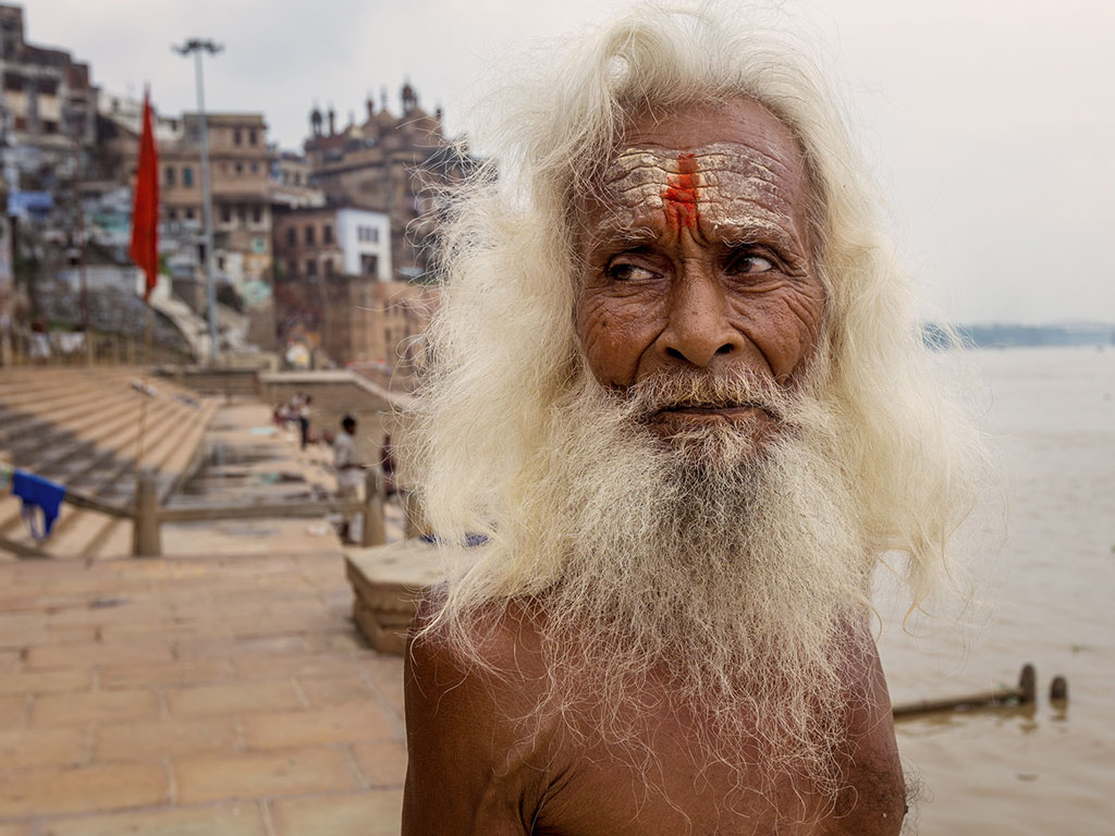 Cloudy skies, the backdrop of the Ganga Ghat in Varanasi and a striking face: there's nothing we don't like about today's Daily Shot.