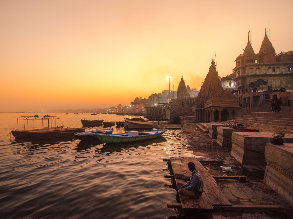 When in Varanasi, don't miss out on watching the sunset from the ghats. Photo by Dilwar Photography/Moment/ Getty Images.