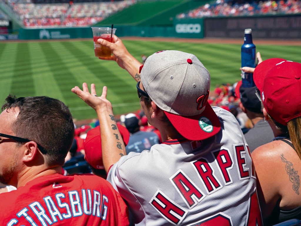 Supporters of the Washington Nationals wait for their team to score against the Colorado Rockies.