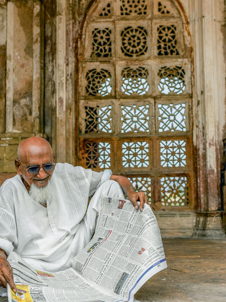 Sarkhej Roza's courtyards, known for its stone trellises, is a favoured reading spot.