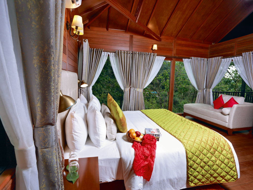 The Ibnii's wooden villas overlook the verdant coffee plantations. Photo Courtesy: The Ibnii