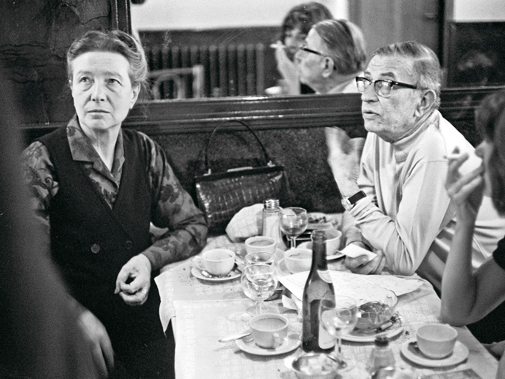Philosopher Simone de Beauvoir, with fellow intellectual Jean-Paul Sartre in 1970s Paris, features among the many women stalwarts on Evans's tours. Photo by: STF/Staff/G/AFP/Getty Images