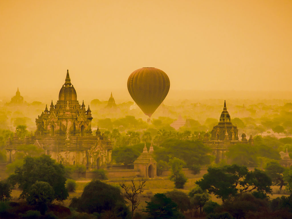 A visit to Myanmar can be chaotic. But to lift your spirits at temple-filled Bagan, float above it all. Photo courtesy: METHEE LAOWATHANATAWON/500PX/National Geographic Creative