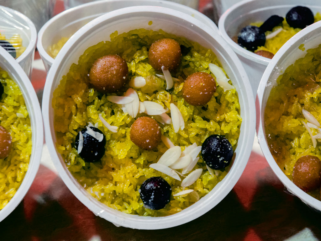 Jorda with mishti, made of sweetened rice with gulabjamuns, is served at weddings.