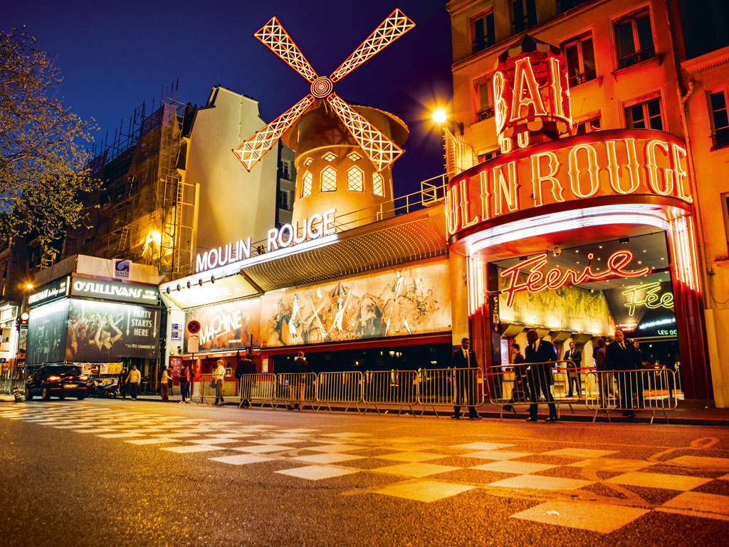Evans is currently working on creating another tour through the lively artistic and red-light quarter of Montmartre, home to the famous cabaret Moulin Rouge. Photo by: Mmeemil/Istock