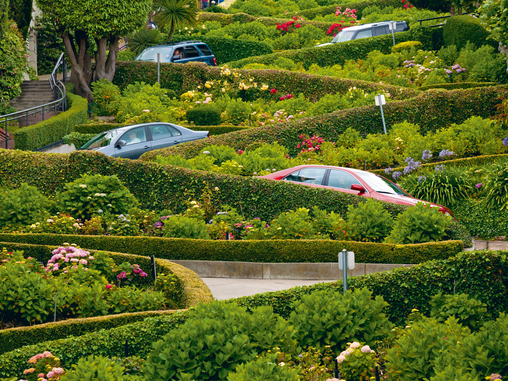 "With eight hairpin turns, Lombard Street is often called the ""crookedest street in the world."" Photo by: Neale Clark/robertharding/Getty Images"