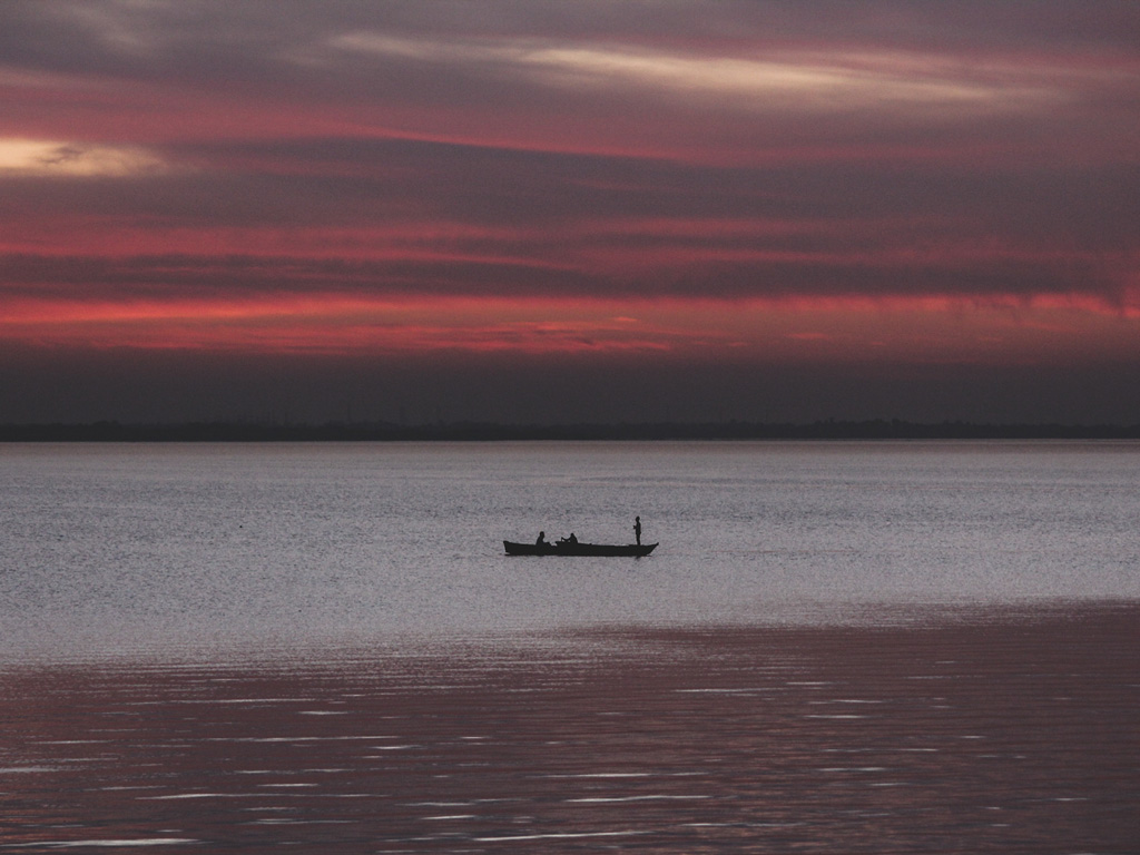 A tourist enjoys a boat ride at the Bhojtal Lake (Upper Lake) in Bhopal at dusk.