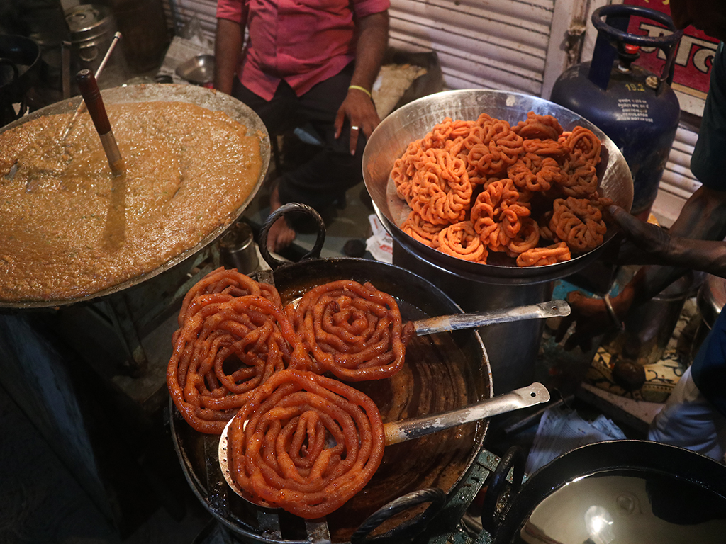 Indore is renown for its street food. In Sarafa Bazaar, the jalebas are gigantic and a must-try.