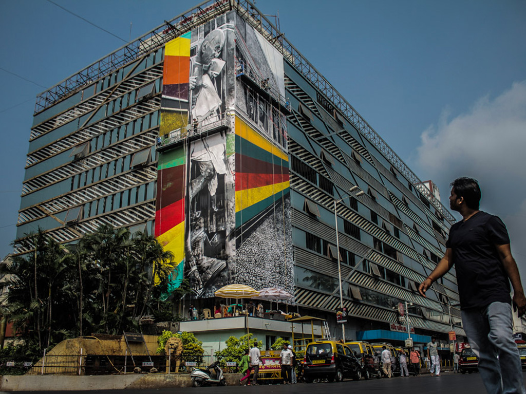 A photorealistic Gandhi mural by Brazilian street artist Eduardo Kobra stands tall at the facade of Churchgate Station. Photo by: Pranav Gohil